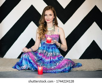 Woman holding candles in her hands. Esotericism, divination, fortune-telling, curses, clairvoyance, summoning spirits, providence, communication with spirits, the afterlife, healing, removal of damage