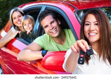 Woman holding a car key. Auto repair service