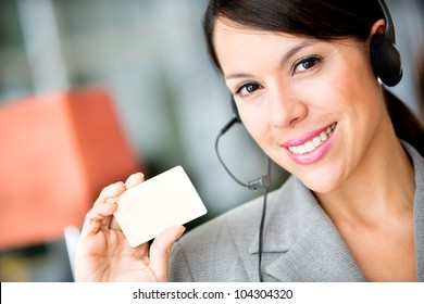 Woman holding a card to include contact detail