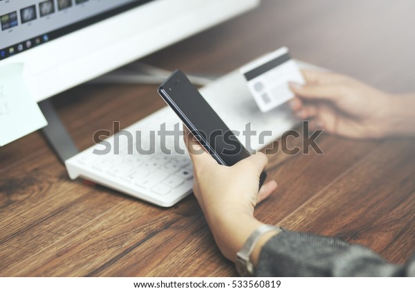 Woman Holding  Card And Using Keyboard