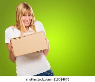 Woman Holding Cardboard box against a green background