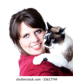 Woman holding a cat in her arms, close-up, isolated on a white background; high contrast.