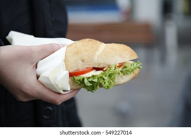 Woman holding a cheese sandwich
