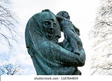 Woman holding child statue Dean Cemetery, Edinburgh Scotland