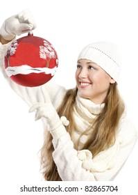 woman holding christmas red ball