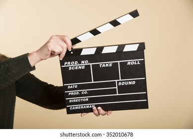 Woman holding a clapper board