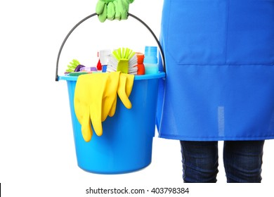 Woman holding cleaning tools and products in bucket, isolated on white