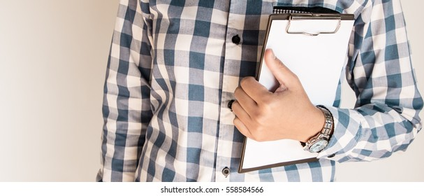 Woman holding a clipboard. Mock up for word and background.