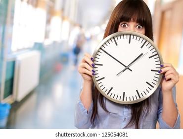 Woman Holding Clock, Indoor