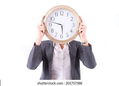 Woman holding a clock over face isolated on a white background. Time concept