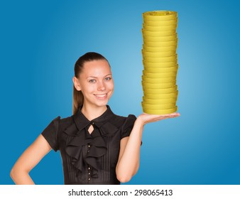 Woman holding coins stack on isolated blue background