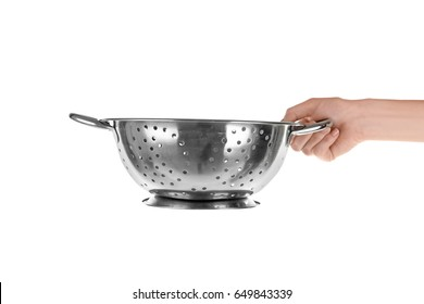 Woman holding colander for cooking classes on white background