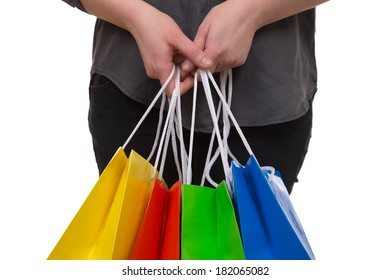 Woman holding colorful shopping bags in her hand, isolated on a white background