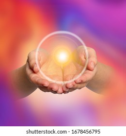 Woman holding concentrated healing energy in her hands, closeup