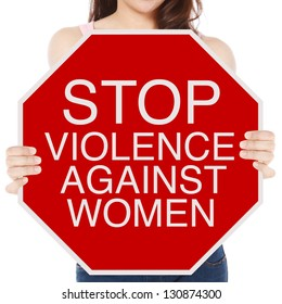 A woman holding a conceptual stop sign on violence against women
