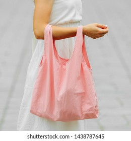 Woman holding cotton eco bag. Reusable eco bag for shopping. Zero waste concept. Mock up