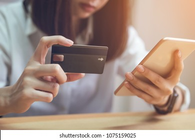 Woman holding credit card pay online and using smartphone for shop through the website. Concepts online shopping for convenience.
