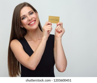 Woman holding credit gold card. Isolated close up face portrait.