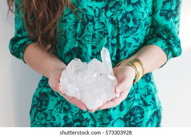 Woman holding a crystal.