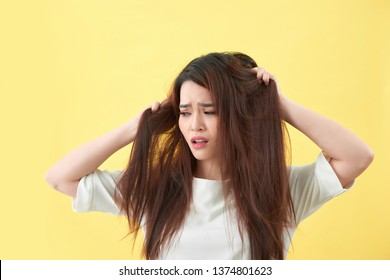Woman holding damaged hair the hand and looking. Isolated portrait