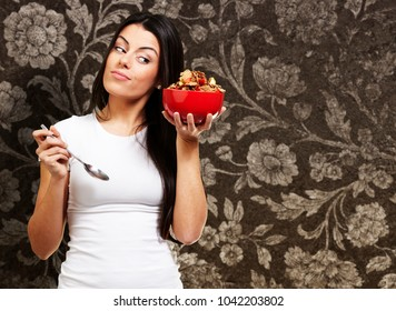 woman holding a delicious red breaksfast bowl against a vintage background