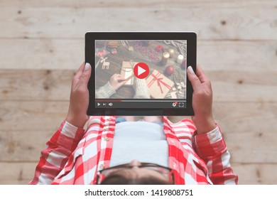 Woman holding digital tablet  and watching  online video tutorial . Concept
