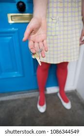 Woman holding door keys