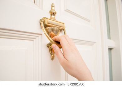 woman holding at the door using the old knock door