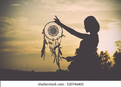 Woman holding the dream catcher