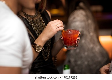 Woman holding a drink - cocktail