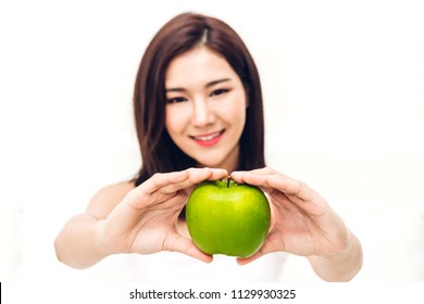 Woman holding and eating fresh green apple on white background.dieting concept.healthy lifestyle