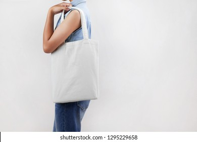 woman holding eco fabric bag isolate on gray background