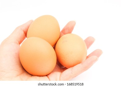woman holding egg with her hand isolated on white background