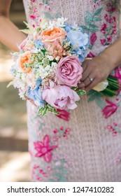 woman holding engagement flowers bouquet