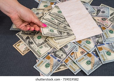 woman holding envelope with dollar . close up