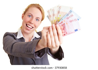 Woman holding a fan made of money