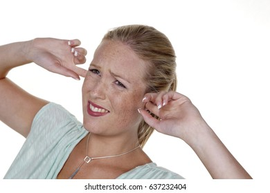 woman holding fingers in his ears