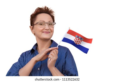 Woman holding flag of Croatia. Nice portrait of middle aged lady 40 50 years old with a national Croatian flag isolated on white background.Learning Croatian language. Visit Croatia concept.