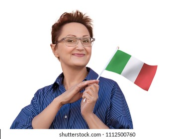 Woman holding flag of Italy. Portrait of middle aged lady 40 50 years old with a national Italian flag isolated on white background. Learning Italian language. Travel to Italy concept. Italian women