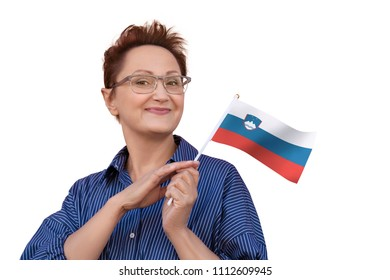 Woman holding flag of Slovenia. Nice portrait of middle aged lady 40 50 years old with a national Slovenian flag isolated on white background.Learning Slovenian language. Visit Slovenia concept.