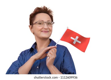 Woman holding flag of Switzerland.  Nice portrait of middle aged lady 40 50 years old with a national Swiss flag isolated on white background.Travel to Switzerland concept. National flag day.