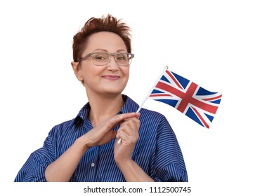 Woman holding flag of UK United Kingdom Great Britain. Nice portrait of middle aged lady 40 50 years old with a national British flag isolated on white background. Learning English /visit UK concept