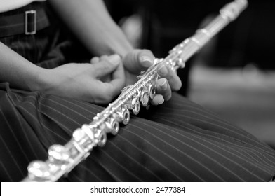 Woman holding a flute
