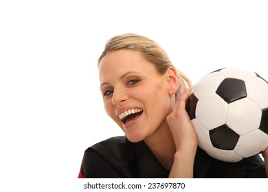 woman holding a football in her hand