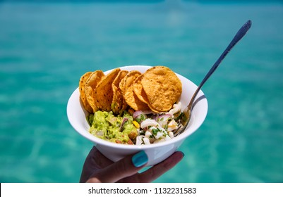 Woman Holding Fresh Ceviche Guacamole and Tortilla Chips Snack Bowl Made in Tropical Paradise
