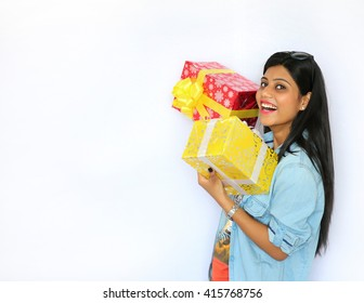 Woman holding gift box Isolated white background.