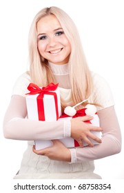 Woman holding gift. Christmas woman portrait of a cute, beautiful smiling Caucasian model.