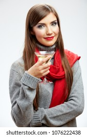 Woman holding glass with alcohol cocktail. Isolated studio portrait.