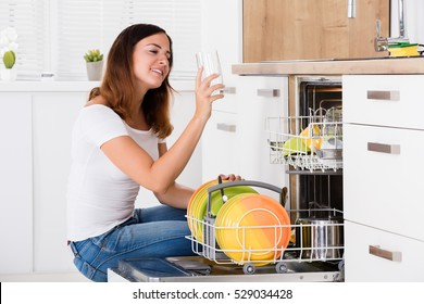 Woman Holding Glass From Dishwasher