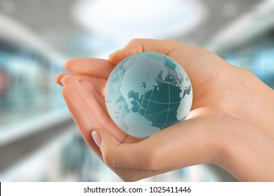 Woman holding a glass globe